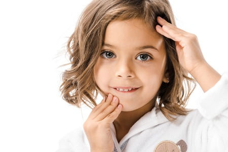 Portrait of adorable child in white bathrobe touching face isolated on white background Stok Fotoğraf