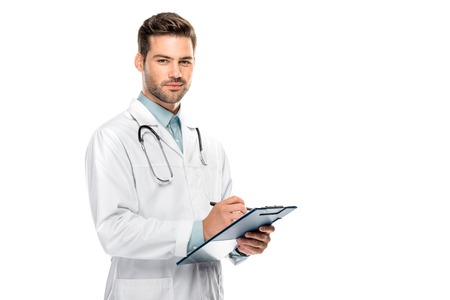 Happy male doctor with stethoscope over neck writing in clipboard isolated on white background
