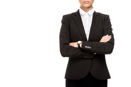 Cropped shot of businesswoman in suit with crossed arms isolated on white background