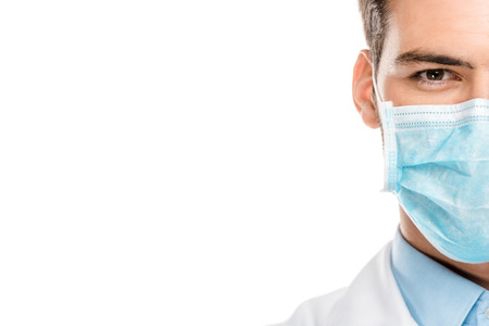 Cropped image of young male doctor in medical mask isolated on white background 版權商用圖片