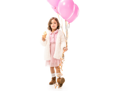 Beautiful stylish child with pink air balloons and ice cream isolated on white background