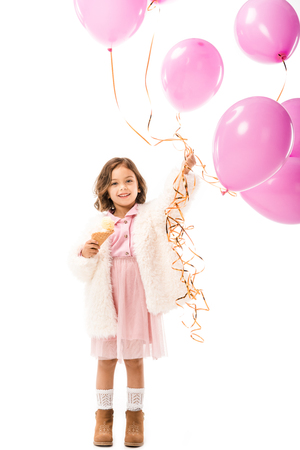 Stylish happy child with pink air balloons and ice cream isolated on white background Banco de Imagens
