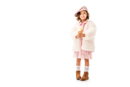 Adorable happy child in stylish clothes with ice cream looking at camera isolated on white background