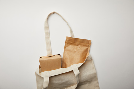 top view of cotton bag with cardboard noodle box on white surface