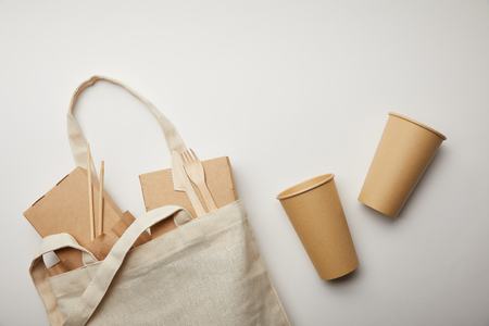 flat lay with cotton bag with food boxes and two disposable coffee cups on white surface Stockfoto