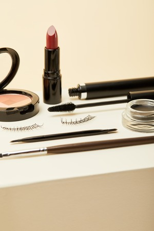 close-up shot of various makeup accessories on beige 스톡 콘텐츠