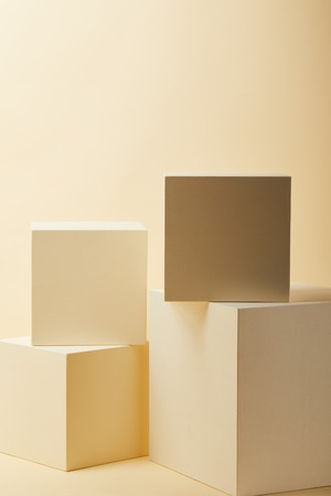 composition of beige cubes in various sizes