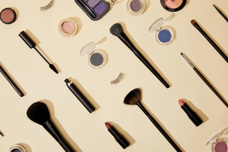 top view of composition of different cosmetics lying on beige surface 스톡 콘텐츠