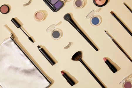 flat lay with composition of various cosmetics lying on beige surface