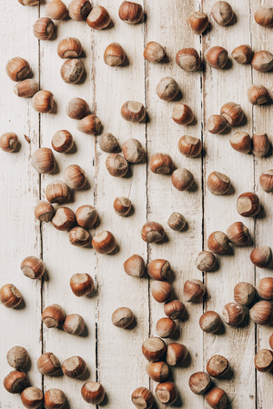 top view of raw ripe healthy hazelnuts on wooden table