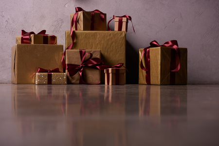 surface level of Christmas gift boxes on floor in room Stock Photo