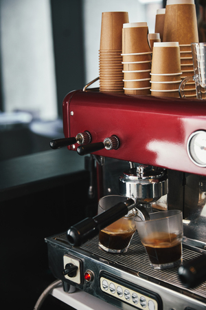 close-up view of professional coffee machine preparing coffee in two glasses Stock Photo