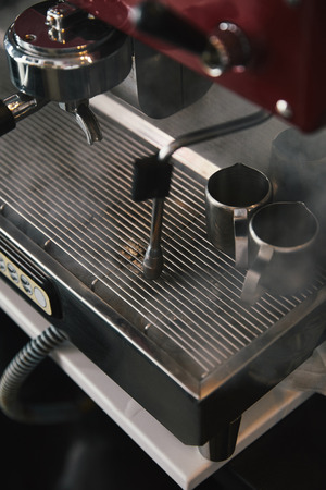 close-up view of professional coffee machine with steam in coffeehouse Stock Photo