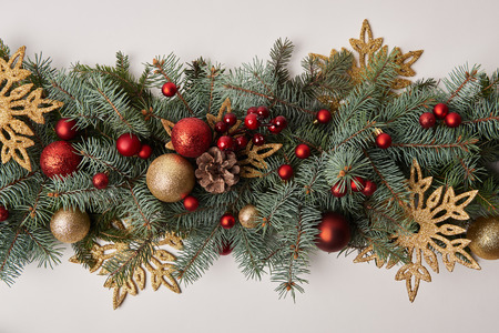 top view of fir twigs with colored Christmas decoration isolated on white Stock Photo