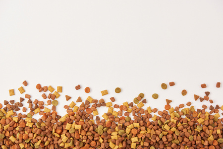 view from above of pile of dog food on white surface Stock Photo