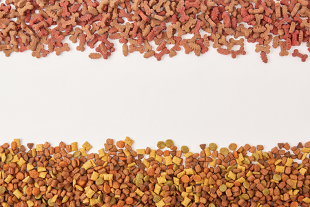 top view of two pile of dog food on white surface Stock Photo