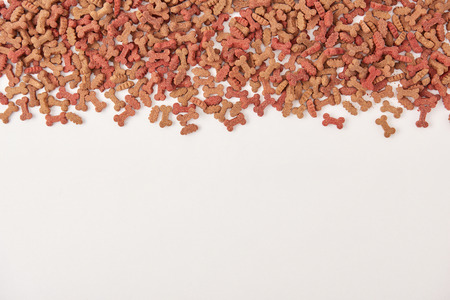 elevated view of pile of pet food on white surface Stock Photo