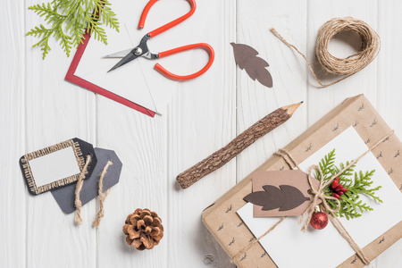 elevated view of decorated christmas present with baubles on wooden table Stock Photo