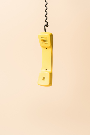 yellow vintage phone tube on beige