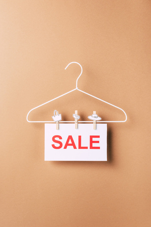 hanger with sale sign for black friday on beige
