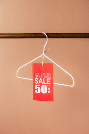 one hanger with red super sale tag - 50 percents on beige