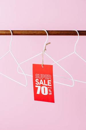 hangers with red super sale tag - seventy percents discount on pink