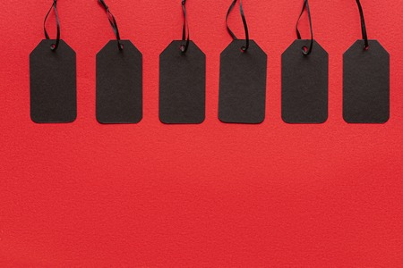 black sale tags isolated on red for special offer on black friday Banque d'images - 110669880