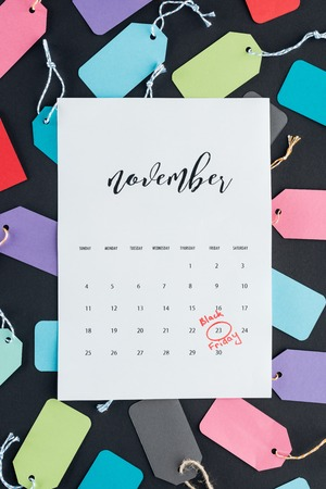 top view of november calendar with black friday sign on colorful sale tags Banque d'images - 110669959