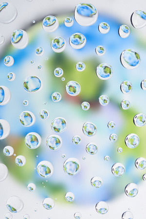 beautiful clear water drops on blurred abstract background