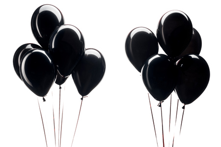 bunches of black balloons isolated on white for black friday