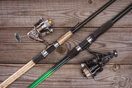 top view of fishing rods on wooden background, minimalistic concept Archivio Fotografico