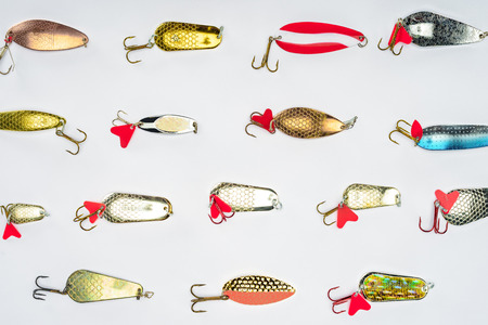 top view of arranged various fishing bait isolated on white Фото со стока
