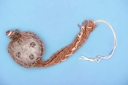 top view of fishing net isolated on blue