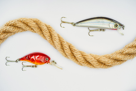 flat lay with nautical rope and fishing bait isolated on white