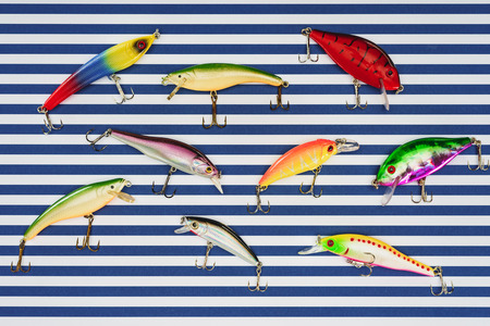 elevated view of various fishing bait on striped background 스톡 콘텐츠