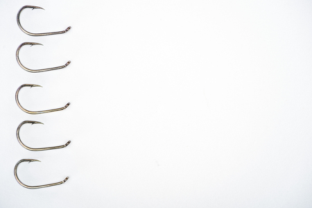top view of fishing hooks placed in row isolated on white Archivio Fotografico - 110699102