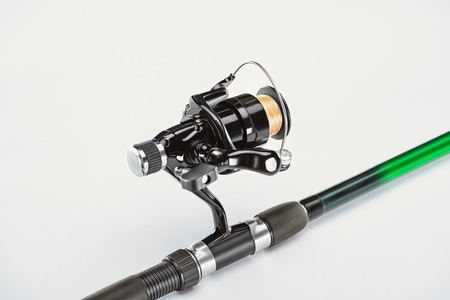 close up view of fishing rod isolated on white, minimalistic concept Stok Fotoğraf