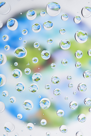 close-up view of beautiful clear water drops on blurred abstract background Zdjęcie Seryjne
