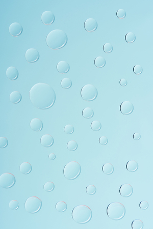 close-up view of transparent water drops on light blue background 版權商用圖片