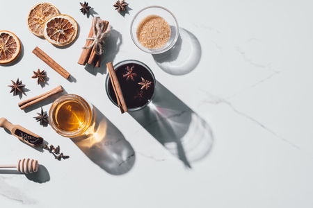 top view of ingredients for mulled wine on white tabletop