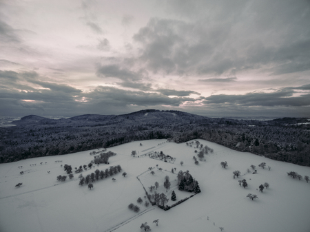 aerial view of beautiful winter landscape with snow-covered trees and hills, Germany