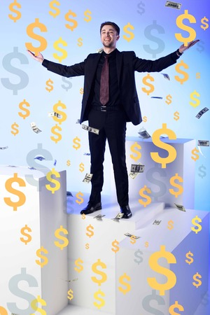 smiling businessman in suit standing on white block with falling dollar banknotes and symbols around
