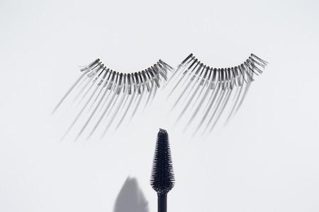 Set of eyelashes with brush on white background