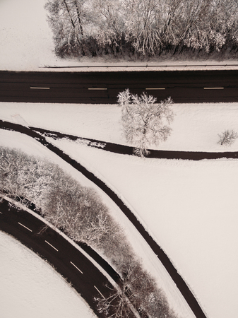 aerial view of empty freeway and snow-covered trees at winter, Germany