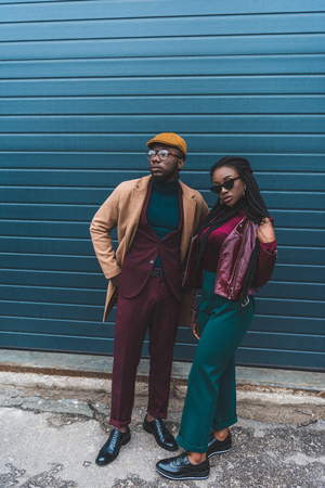 full length view of fashionable african american couple posing together on street Stock Photo