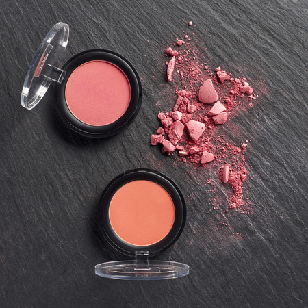 Broken blush by pressed blush on dark slate background