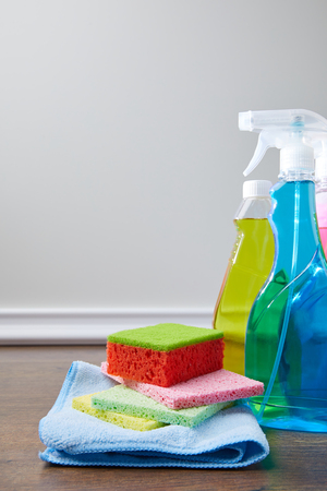bottles with antiseptic liquids and rags for spring cleaning Stock Photo