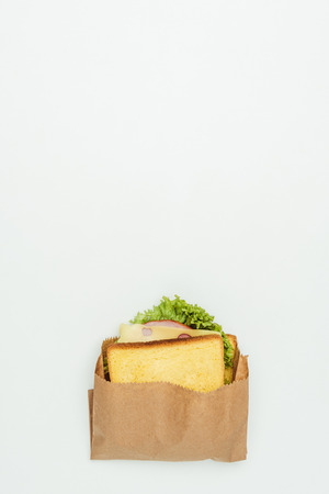 top view of sandwich in paper bag isolated on white