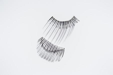 Set of long fake eyelashes on white background 스톡 콘텐츠