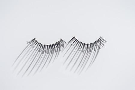 Long fake eyelashes on white background